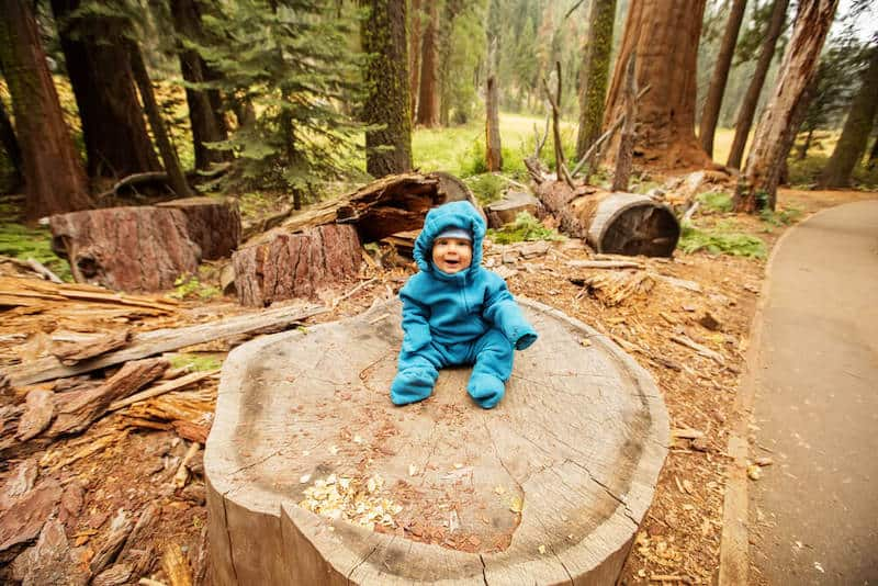 baby hippie in the woods
