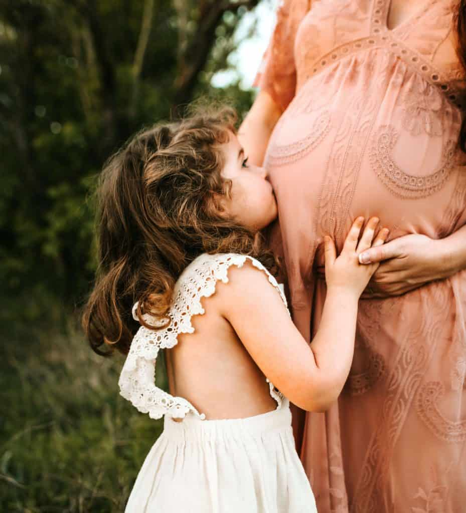 boho pregnant mother and daughter