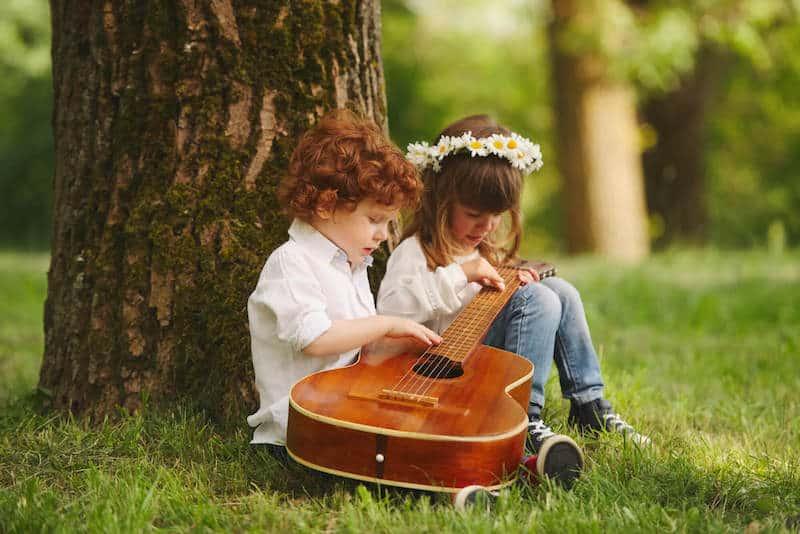 hippie children playing guitar