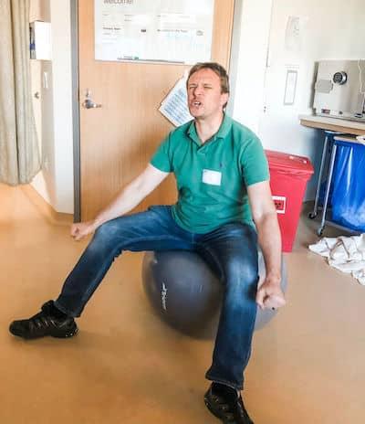 husband on birthing ball