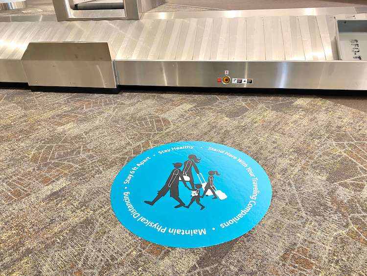 social distancing sticker at baggage claim